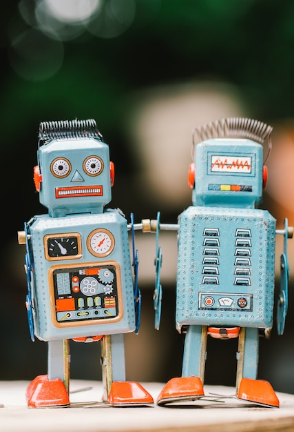 Vintage robot tin toy on yello background Premium Photo