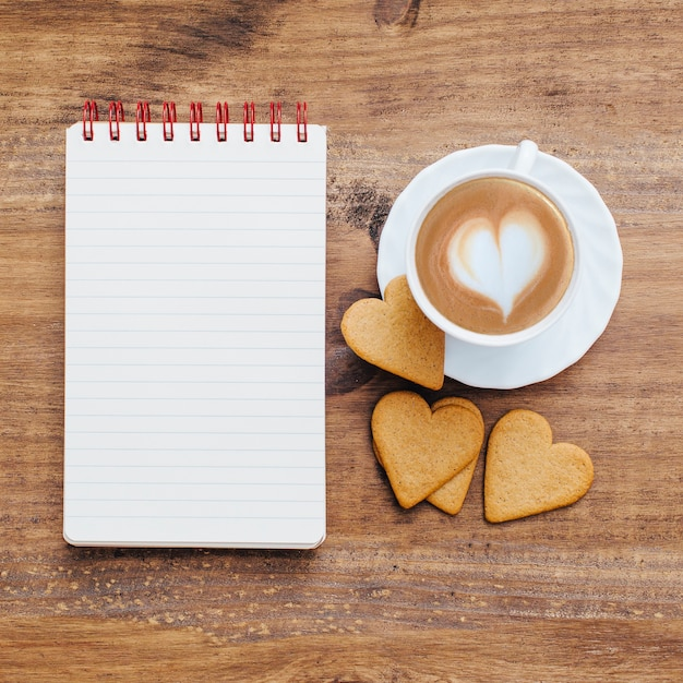 Vintage school notebook with breakfast and coffee. Free Photo