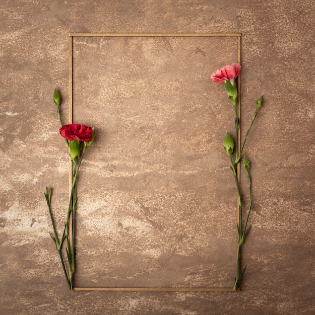 Vintage sepia frame with small carnation flowers Free Photo