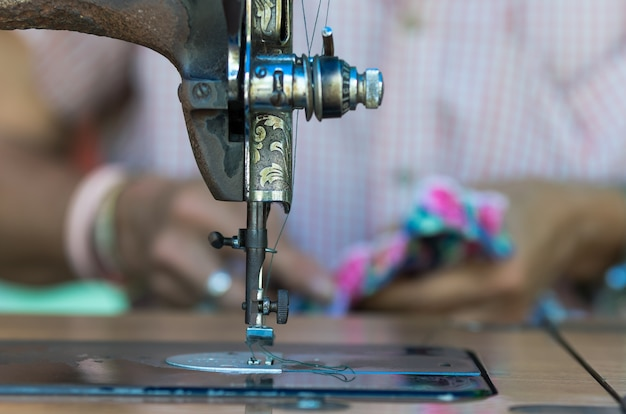The vintage sewing machine on fashion designer blur background Premium Photo