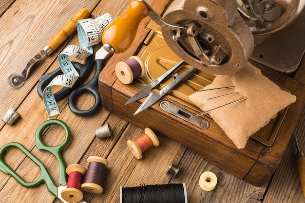Vintage sewing machine with thread and scissors Free Photo