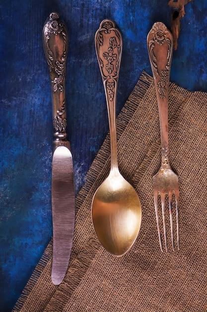 Vintage silverware on rustic blue wooden background. Premium Photo