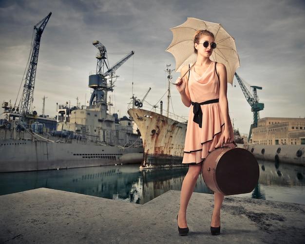 Vintage style woman at a port Premium Photo