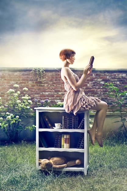 Vintage style woman reading a book Premium Photo