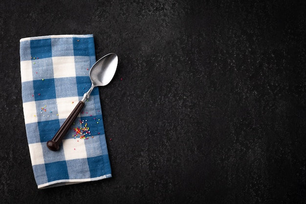Vintage table with spoon and napery Premium Photo
