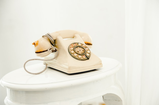 Vintage telephone old telephone on white room background. Premium Photo