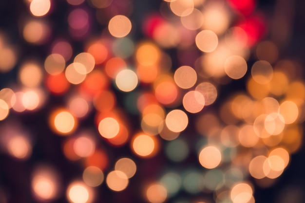 Vintage tone bokeh on dark romantic magic night  background colorful. Premium Photo