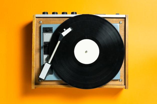 Vintage turntable vinyl record player. retro sound technology to play music Premium Photo