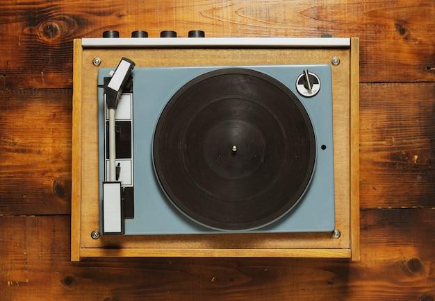 Vintage turntable vinyl record player on wood Premium Photo