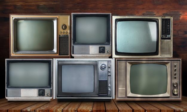 Vintage tv on wood shelf background Photo | Premium Download