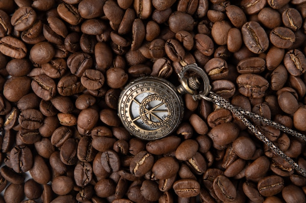 Vintage watch with coffee Free Photo