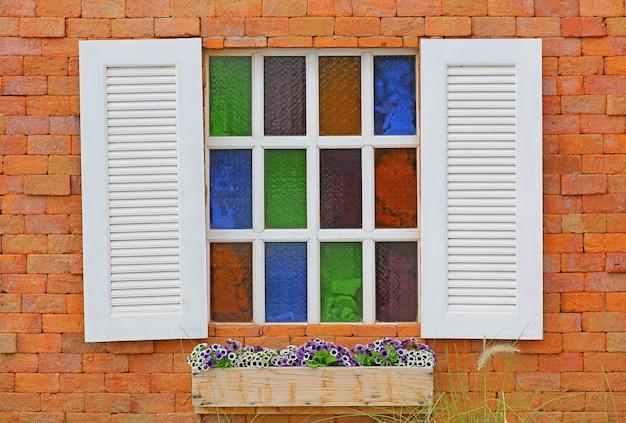Vintage white window on red brick wall Premium Photo