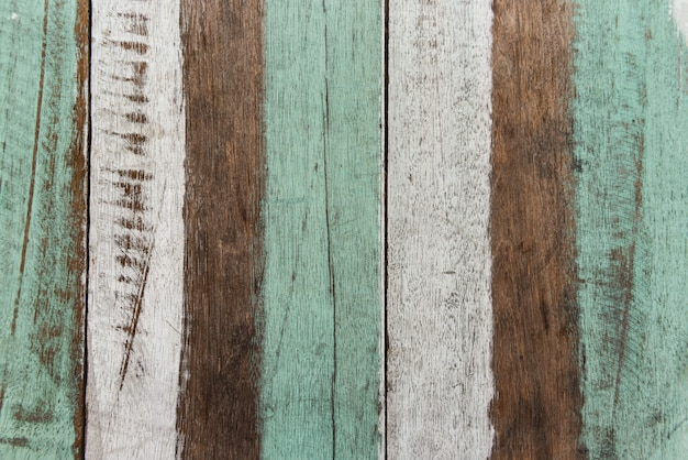 Vintage wood background texture old wood material. vintage wallpaper colors patterned of brightly colored panels of weathered painted wooden boards Premium Photo