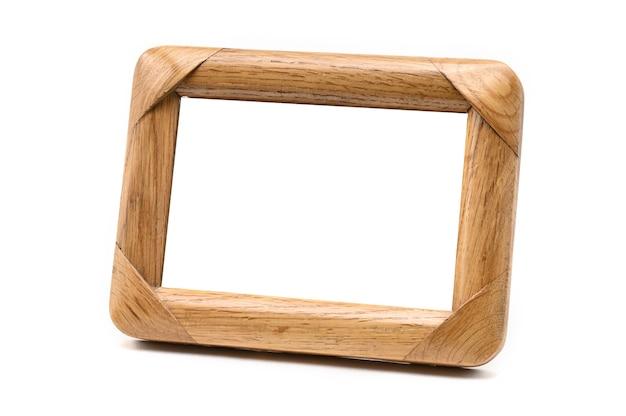 孤立した白い背景の上のビンテージ木製フォトフレーム。 Premium写真