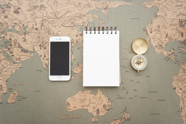 Vintage world map background with notebook compass and mobile phone vintage world map background with notebook compass and mobile phone free photo gumiabroncs Image collections