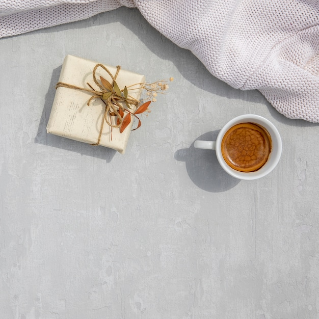 Vintage wrapped gift with a cup of coffee Free Photo