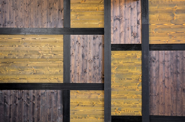 Vintage yellow and dark brown color lumber background Photo