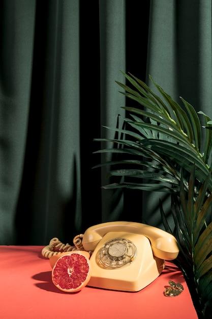 Vintage yellow telephone on table Free Photo