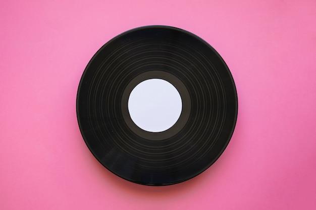 Виниловый макет на розовом фоне Бесплатные Фотографии
