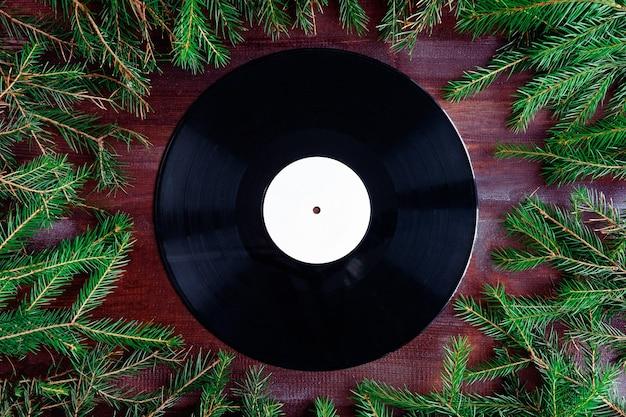 Vinyl record in christmas composition Premium Photo