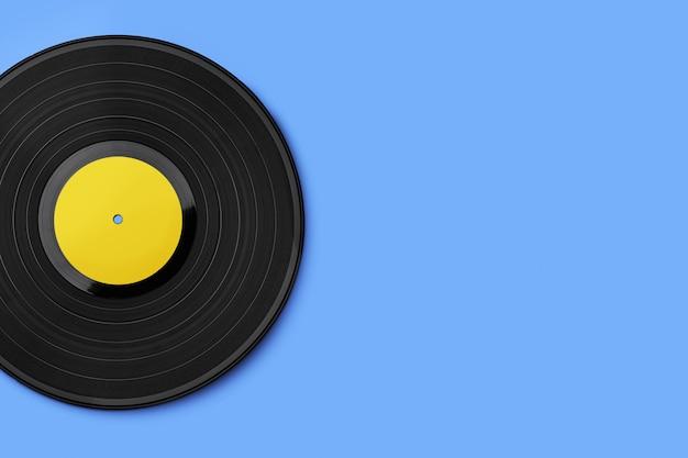 Vinyl record on a colored background Premium Photo