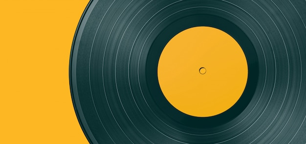Vinyl record on a colored background Premium Photo