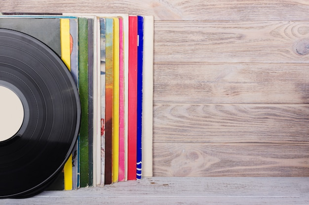 Vinyl records and headphones on table. vintage vinyl disk Premium Photo