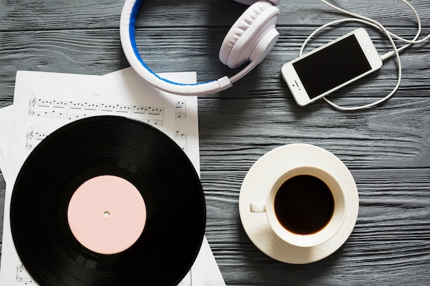 Vinyl, smartphone and coffee  Free Photo