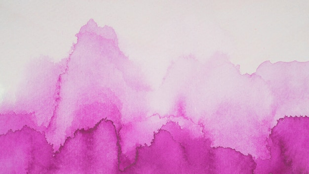 Violet blots of paints on white paper Free Photo