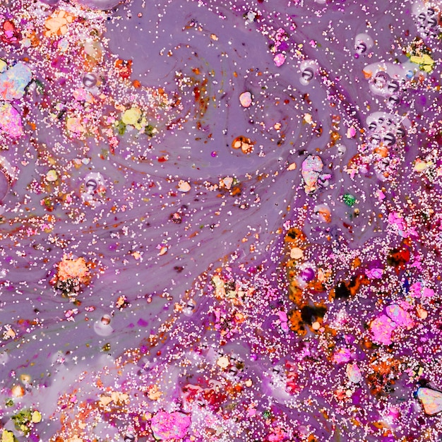Violet liquid with colourful crumbs Free Photo