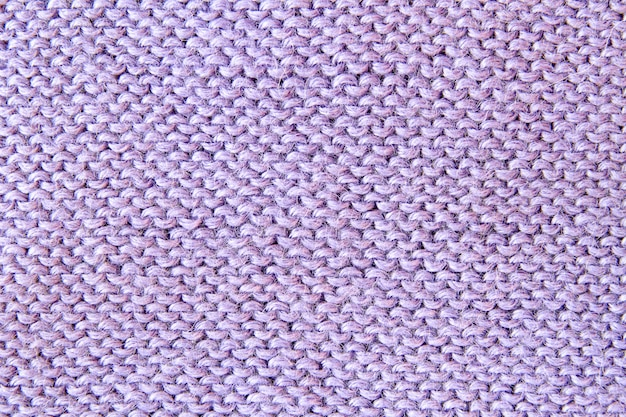 Violet or purple knitted textured background. closeup Premium Photo