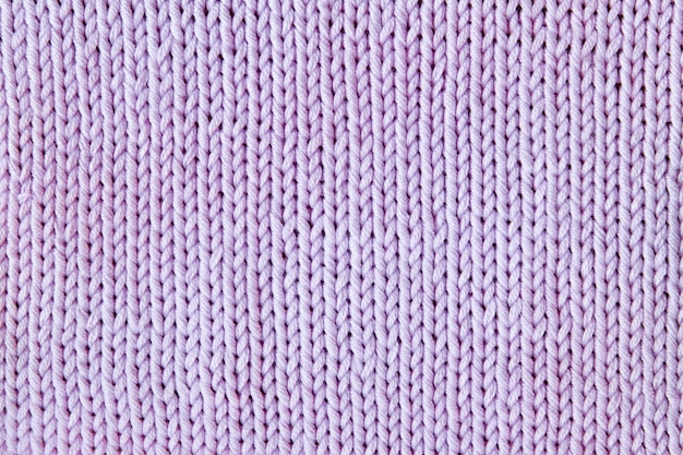 Violet or purple knitted textured background Premium Photo