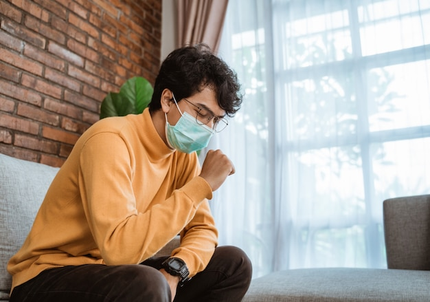 Virus symptoms. male wearing face masks Premium Photo