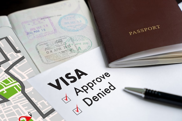 Visa and passport to approved stamped on a document top view in immigration Premium Photo