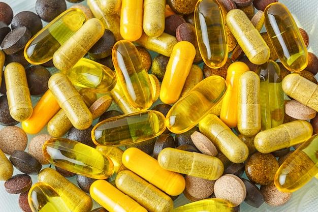 Vitamin pills texture background Premium Photo