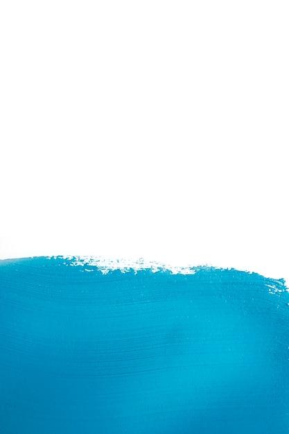 Vivid blue colored paint brushstroke Free Photo