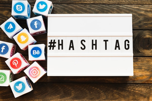 Vivid social networking icons blocks besides hashtag text Free Photo