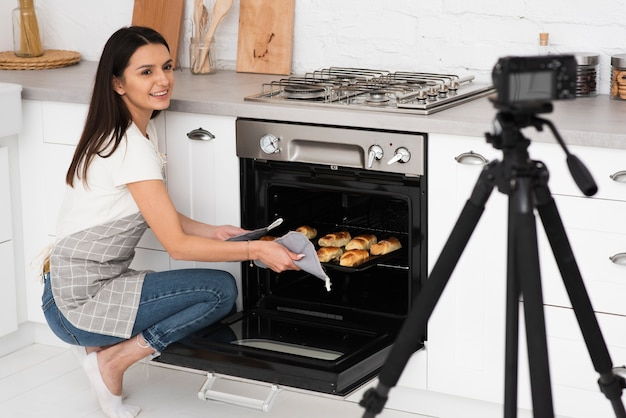 Vlogger recording for a cooking show Free Photo