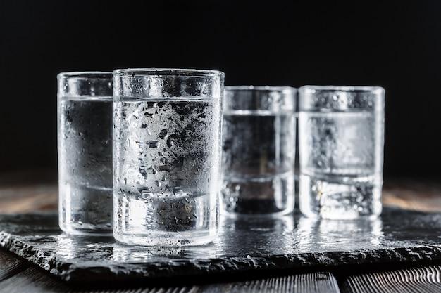 Vodka in  glasses on rustic wood Premium Photo