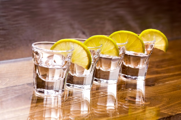 Vodka glasses on the table Free Photo