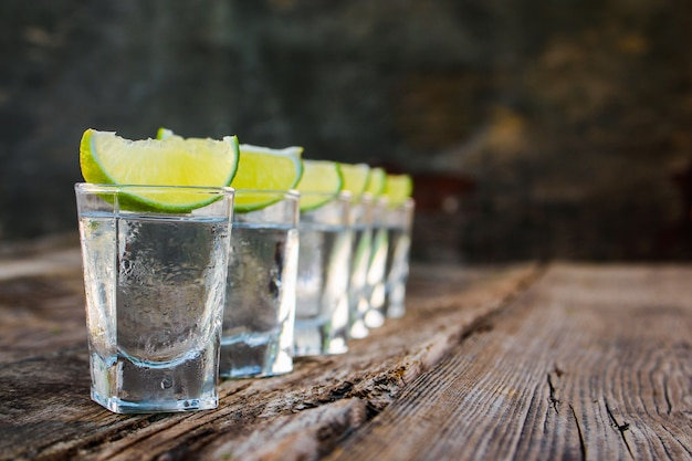 Vodka and lime slices Premium Photo
