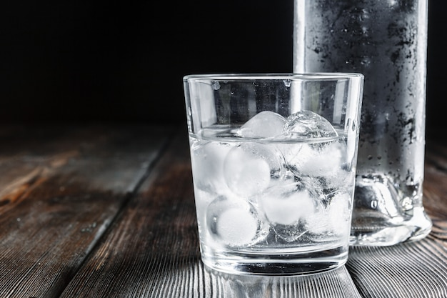 Vodka in shot glasses on rustic wood Premium Photo