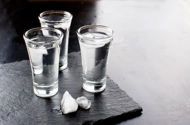 Vodka shots on black table Premium Photo