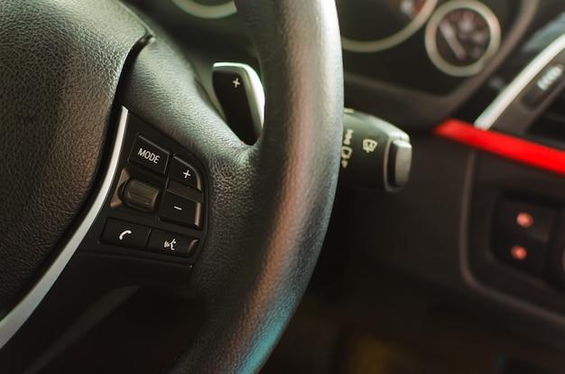 Volume keys on the steering wheel Premium Photo