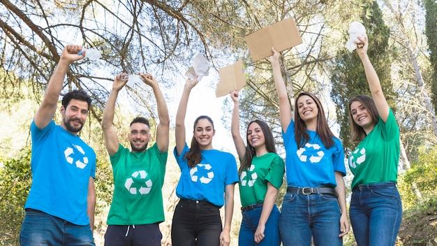 Volunteers holding trash in park Premium Photo