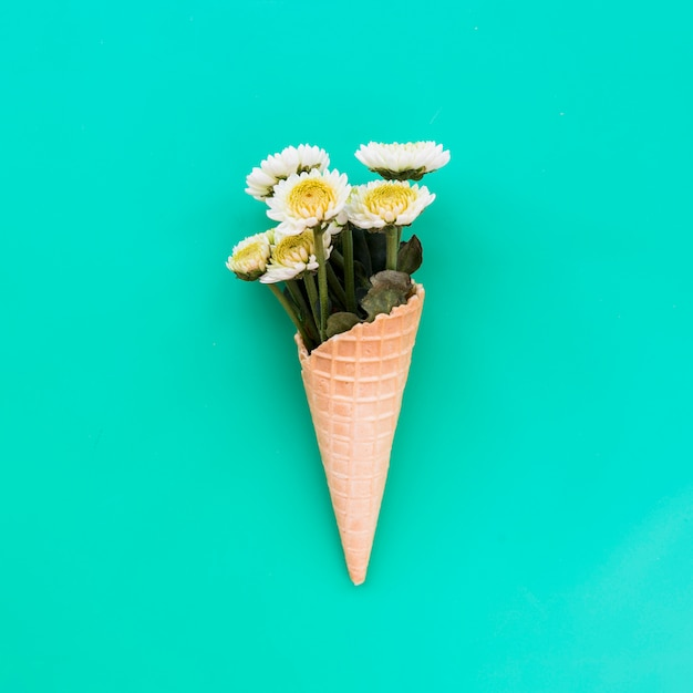 Waffle cone with bunch of fresh flowers Free Photo