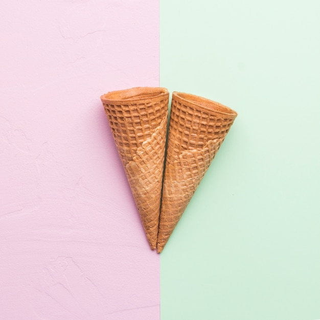 Waffle cones on different color background Free Photo