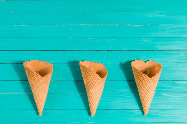 Waffle cones in row on table Free Photo