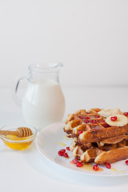 Waffle with milk and honey Free Photo