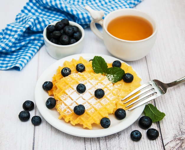 Waffles with blueberries Premium Photo